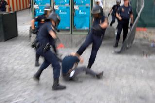 Police and protestor, Madrid demonstration, Spain, 22 May 2006.
